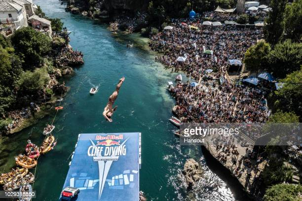 In this handout image provided by Red Bull, Catalin Preda of Romania dives from the 27 metre platform on Stari Most during the final competition day...