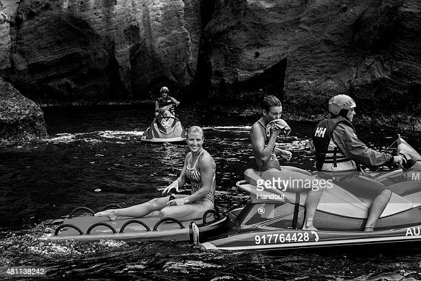 In this handout image provided by Red Bull Cesilie Carlton of the USA and Anna Bader of Germany after diving from a 20 metre cliff during the first...
