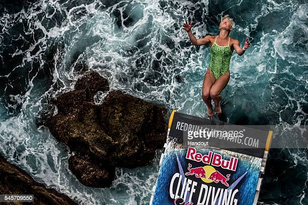 In this handout image provided by Red Bull Cesilie Carlton of the USA dives from the 205 metre platform at Islet Franca do Campo during the third...