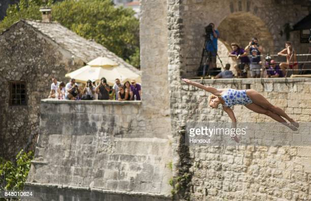 In this handout image provided by Red Bull Cesilie Carlton of the USA dives from the 21 metre platform on Stari Most during the fifth stop of the Red...