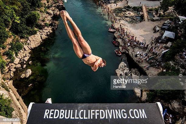 In this handout image provided by Red Bull David Colturi of the USA dives from the 28 metre platform on the Stari Most bridge during the second...