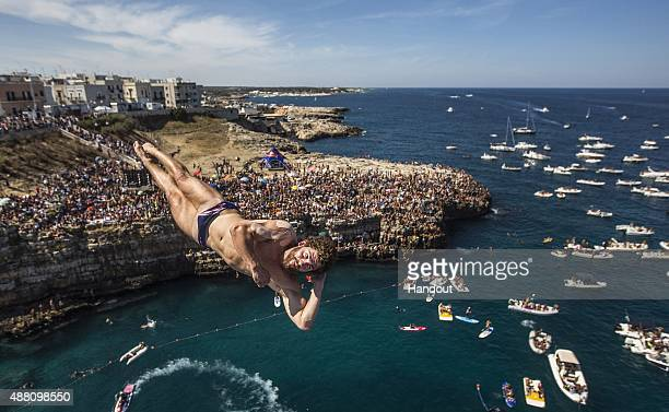 In this handout image provided by Red Bull David Colturi of the USA dives from the 275 metre platform during the seventh stop of the Red Bull Cliff...