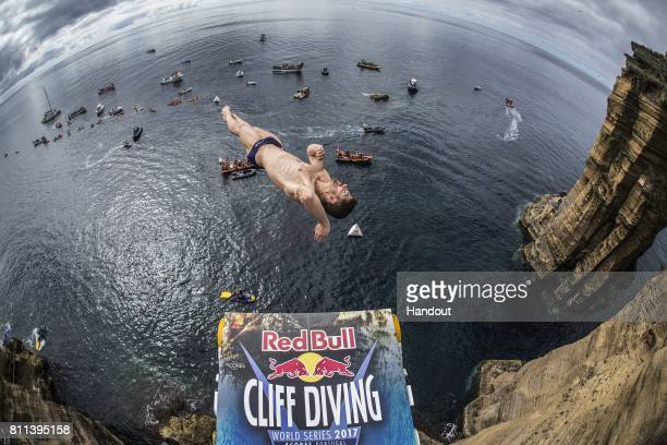 In this handout image provided by Red Bull David Colturi of the USA dives from the 27 metre platform at Islet Franca do Campo during the second stop...