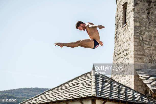 In this handout image provided by Red Bull David Colturi of the USA dives from the 27 metre platform on Stari Most during the first competition day...