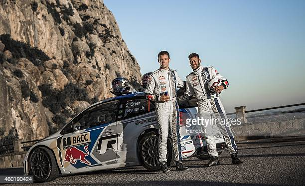 In this handout image provided by Red Bull Double world rally champion Sebastien Ogier of France and Neymar da Silva Santos Junior of Brazil after a...