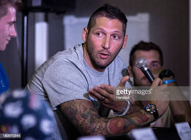 In this handout image provided by Red Bull Former Italian national football player Marco Materazzi talks during a press conference at Zojoji Temple...