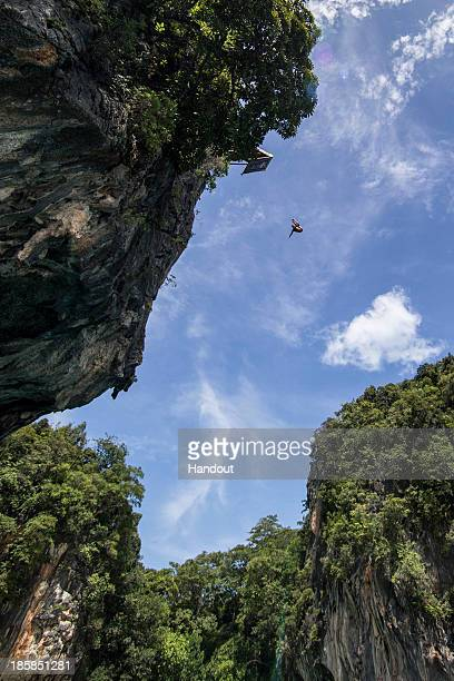In this handout image provided by Red Bull Gary Hunt of the UK dives from the 27 metre platform at training on Hong Island in the Andaman Sea during...