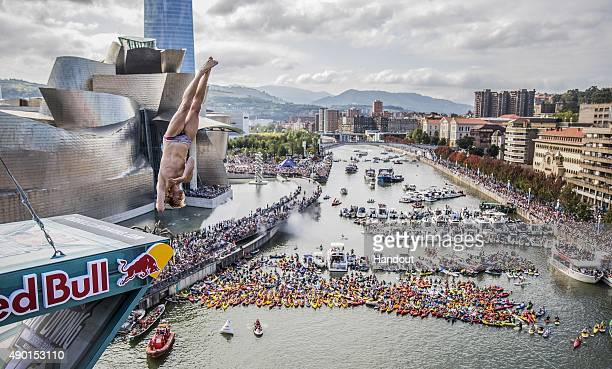 In this handout image provided by Red Bull Gary Hunt of the UK dives from the 275 metre platform on La Salve bridge during the eighth and final stop...