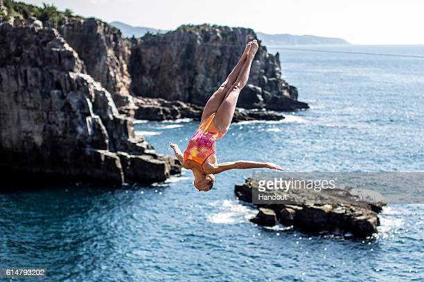 In this handout image provided by Red Bull, Helena Merten of Australia dives from the 28 metre platform during the first competition day of the...