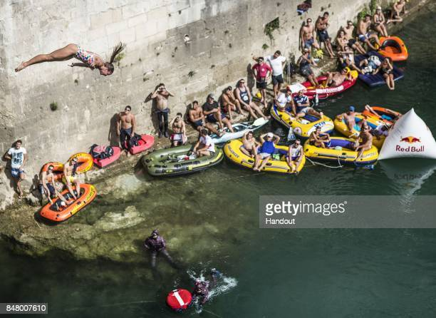 In this handout image provided by Red Bull Helena Merten of Australia dives from the 21 metre platform on Stari Most during the fifth stop of the Red...