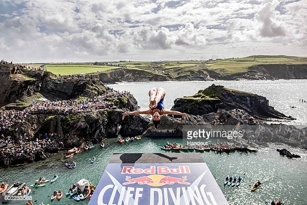In this handout image provided by Red Bull Jackie Valente of Brazil dives from the 20 metre platform at the Blue Lagoon during the sixth stop of the...