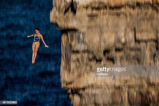 In this handout image provided by Red Bull Jacqueline Valente of Brazil dives from the 22 metre platform during the first rounds of the seventh stop...