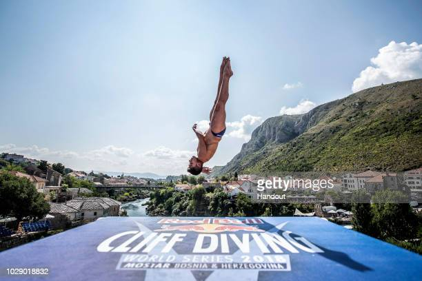 In this handout image provided by Red Bull Jonathan Paredes of Mexico dives from the 27 metre platform on Stari Most bridge during the first...