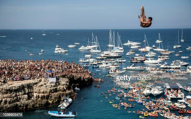 In this handout image provided by Red Bull Jonathan Paredes of Mexico dives from the 27 metre platform during the last competition day of the seventh...