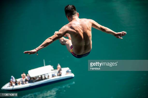 In this handout image provided by Red Bull Jonathan Paredes of Mexico dives from the 27 metre platform at the Big Lagoon on Miniloc Island during the...