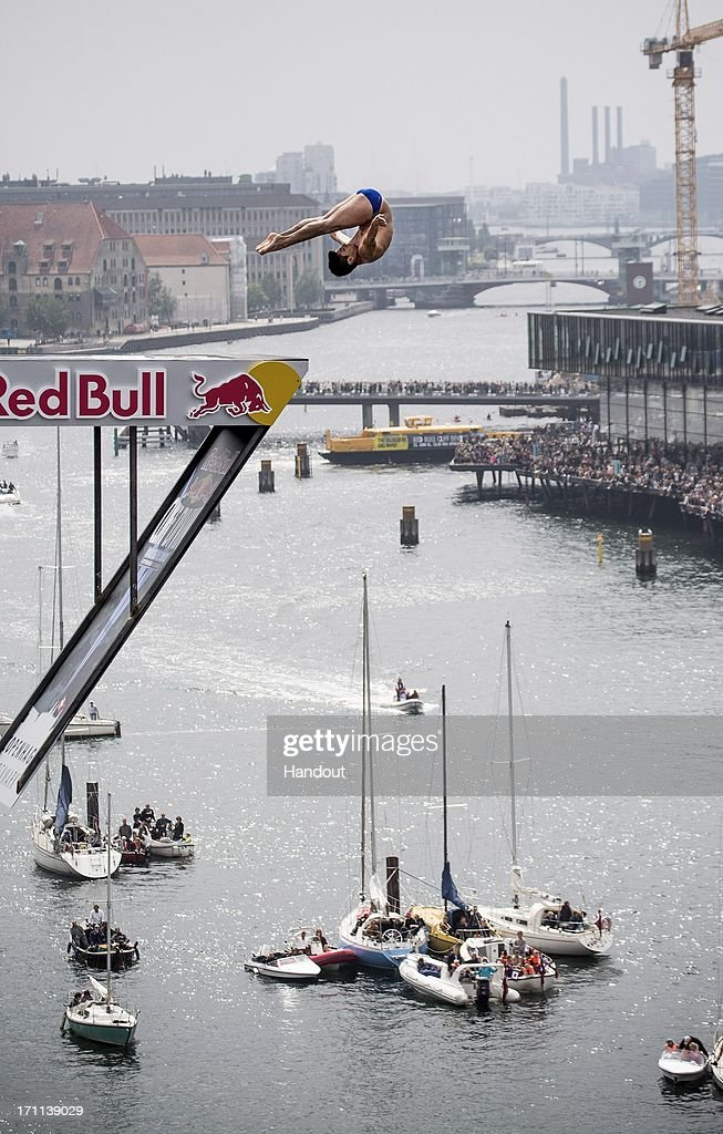 In this handout image provided by Red Bull, Jonathan Paredes of Mexico dives from the 28 metre platform at the Copenhagen Opera House during the second stop of the Red Bull Cliff Diving World Series on June 22, 2013 at Copenhagen, Denmark.