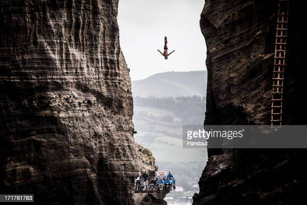 In this handout image provided by Red Bull Jonathan Paredes of Mexico dives from the 27 metre platform during the first competition day of the third...