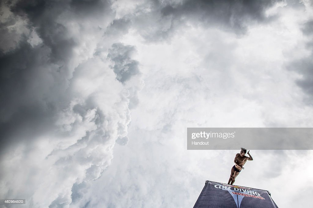 In this handout image provided by Red Bull, Jonathan Paredes of Mexico dives from the 27 metre platform during the final rounds of the Red Bull Cliff Diving World Series qualification competition at Piscinas Panamericanas, Cali, Colombia.
