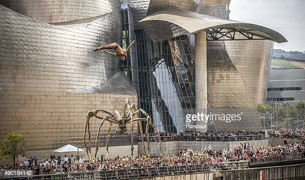 In this handout image provided by Red Bull Jonathan Paredes of Mexico dives from the 275 metre platform on La Salve bridge during the eighth and...
