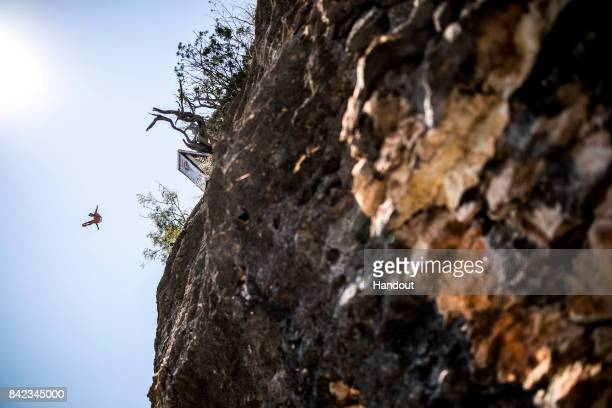 In this handout image provided by Red Bull Jonathan Paredes of Mexico dives from the 27 metre platform during the fourth stop of the Red Bull Cliff...