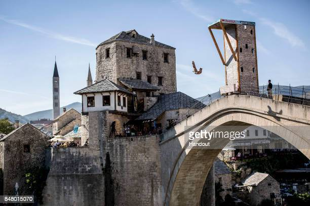 In this handout image provided by Red Bull Jonathan Paredes of Mexico dives from the 27 metre platform on Stari Most during the first competition day...