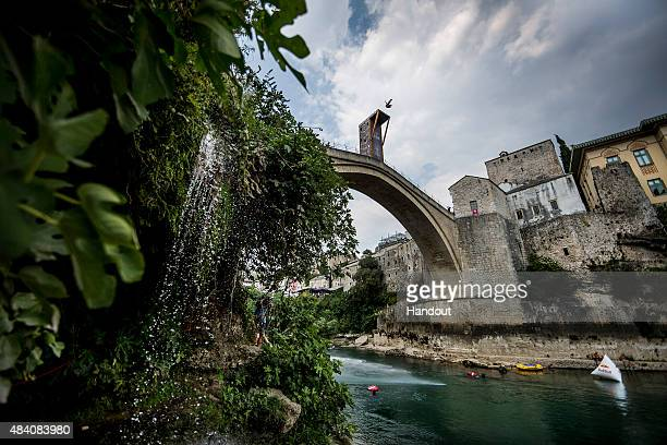 In this handout image provided by Red Bull Jorge Ferzuli of Mexico dives from the 28 metre platform on the Stari Most bridge during the seeding round...