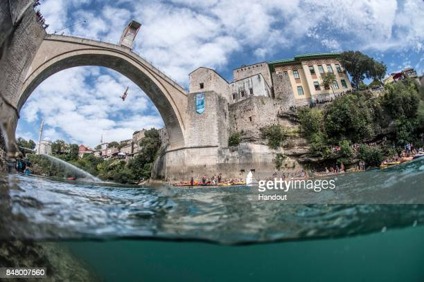In this handout image provided by Red Bull Kris Kolanus of Poland dives from the 27 metre platform on Stari Most during the fifth stop of the Red...