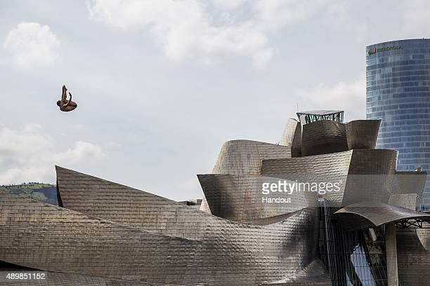 In this handout image provided by Red Bull Kyle Mitrione of the USA dives from the 275 metre platform on La Salve bridge next to the Guggenheim...
