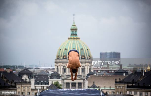 In this handout image provided by Red Bull Kyle Mitrione of the USA dives from the 28 metre platform on the Copenhagen Opera House during the first...