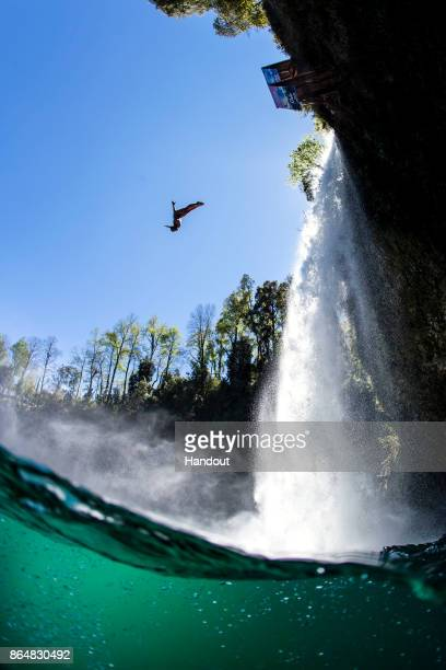 In this handout image provided by Red Bull Kyle Mitrione of the USA dives from the 27 metre platform during the sixth and final stop of the Red Bull...