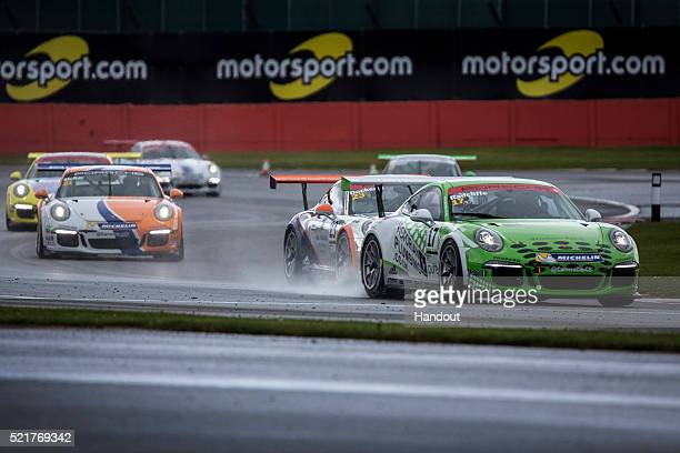 In this handout image provided by Red Bull Mark Radcliffe of the UK leads a group of cars during race one of the Porsche Carrera Cup GB during the...
