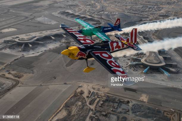 In this handout image provided by Red Bull Martin Sonka of the Czech Republic and Yoshihide Muroya of Japan fly over the new airport prior to the...
