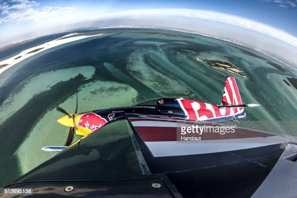 In this handout image provided by Red Bull Martin Sonka of the Czech Republic fly over the mangroves prior to the first stage of the Red Bull Air...