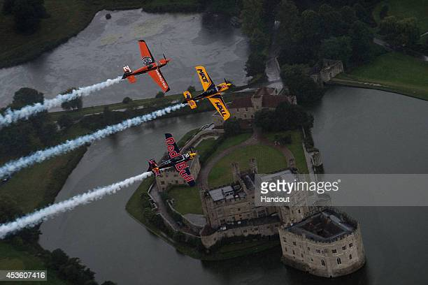 In this handout image provided by Red Bull, Matt Hall of Australia and Nicolas Ivanoff of France fly in formation with Kirby Chambliss of the United...