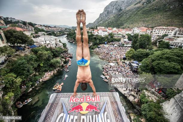 In this handout image provided by Red Bull, Michal Navratil of the Czech Republic prepares to dive from the 27 metre platform on Stari Most during...