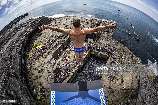 In this handout image provided by Red Bull Michal Navratil of the Czech Republic dives from the 28 metre platform at the Serpent's Lair during the...