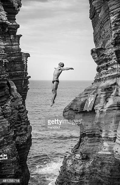 In this handout image provided by Red Bull Michal Navratil of the Czech Republic dives from the 27 meter cliff face during the fifth stop of the Red...
