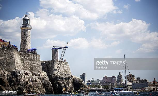 In this handout image provided by Red Bull Michal Navratil of the Czech Republic dives from the 27 metre platform on Morro Castle during the seeding...