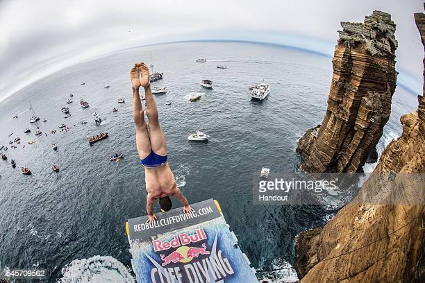In this handout image provided by Red Bull Michal Navratil of the Czech Republic prepares to launch an armstand dive from the 27 metre platform at...