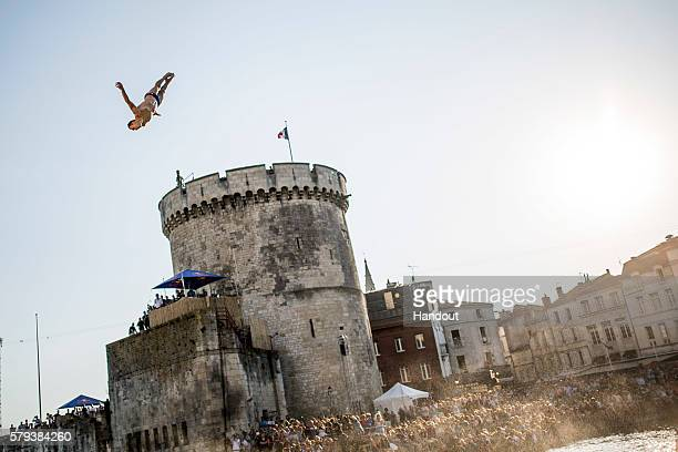 In this handout image provided by Red Bull Michal Navratil of the Czech Republic dives from the 27 metre platform on the Saint Nicolas Tower during...
