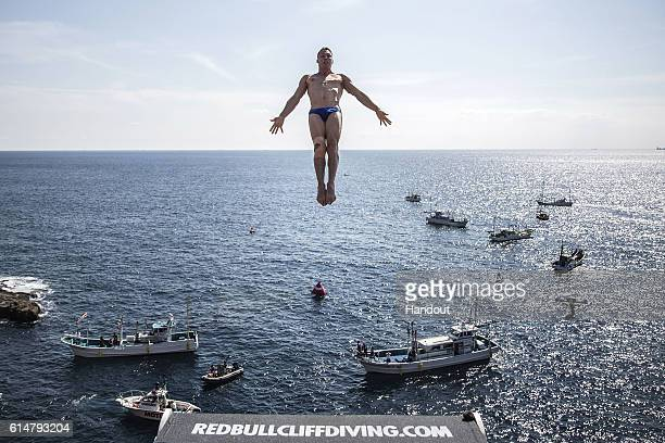 In this handout image provided by Red Bull Michal Navratil of the Czech Republic dives from the 28 metre platform during the first competition day of...