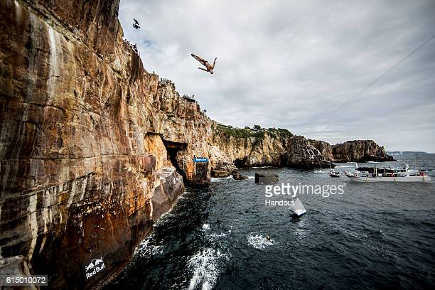 In this handout image provided by Red Bull Michal Navratil of the Czech Republic dives from the 28 metre platform during the eighth stop of the Red...
