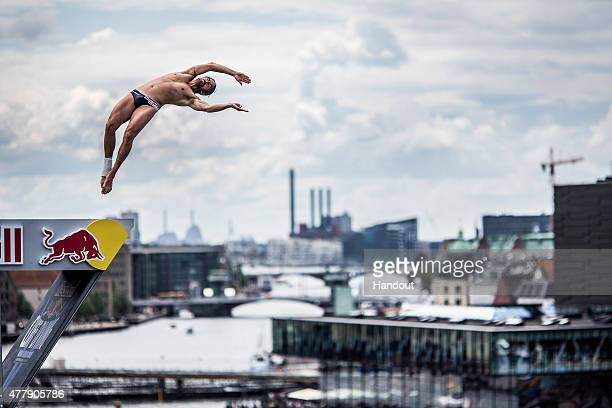 In this handout image provided by Red Bull Orlando Duque of Colombia dives from the 28 metre platform on the Copenhagen Opera House during the fourth...