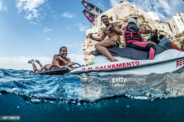In this handout image provided by Red Bull Orlando Duque of Colombia and Jonathan Paredes of Mexico react after their dives from the 275 metre during...