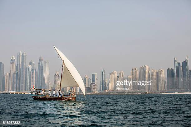In this handout image provided by Red Bull Orlando Duque of Colombia and Helena Merten of Australia take in the views while sailing on a traditional...