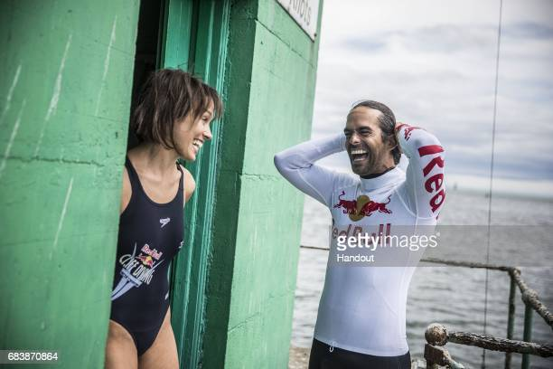 In this handout image provided by Red Bull Orlando Duque of Colombia and Anna Bader of Germany prepare to dive off the iconic Northbank Lighthouse in...