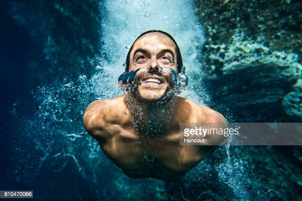 In this handout image provided by Red Bull Orlando Duque of Colombia underwater after a dive on Islet Franca do Campo the second stop of Red Bull...