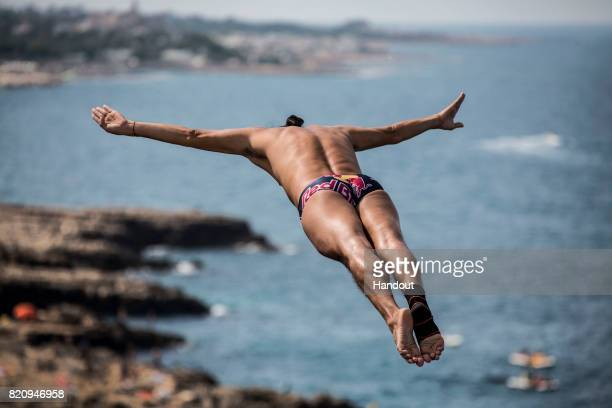 In this handout image provided by Red Bull Orlando Duque of Colombia dives from the 27 metre platform during the first competition day of the third...