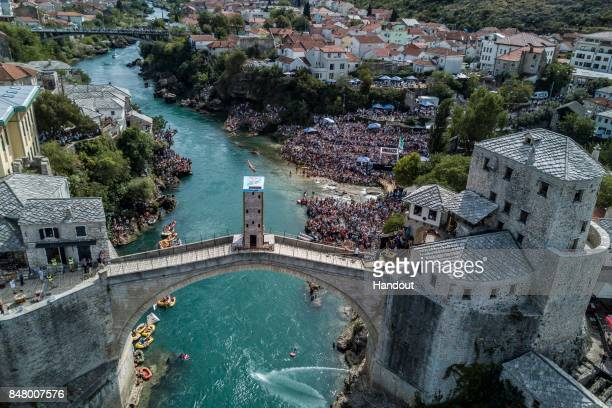 In this handout image provided by Red Bull Orlando Duque of Colombia dives from the 27 metre platform on Stari Most during the fifth stop of the Red...