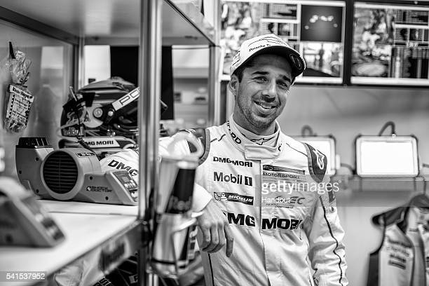 In this handout image provided by Red Bull, Porsche LMP1 driver Neel Jani of Switzerland in the garage drivers area prior to the start of the 24...